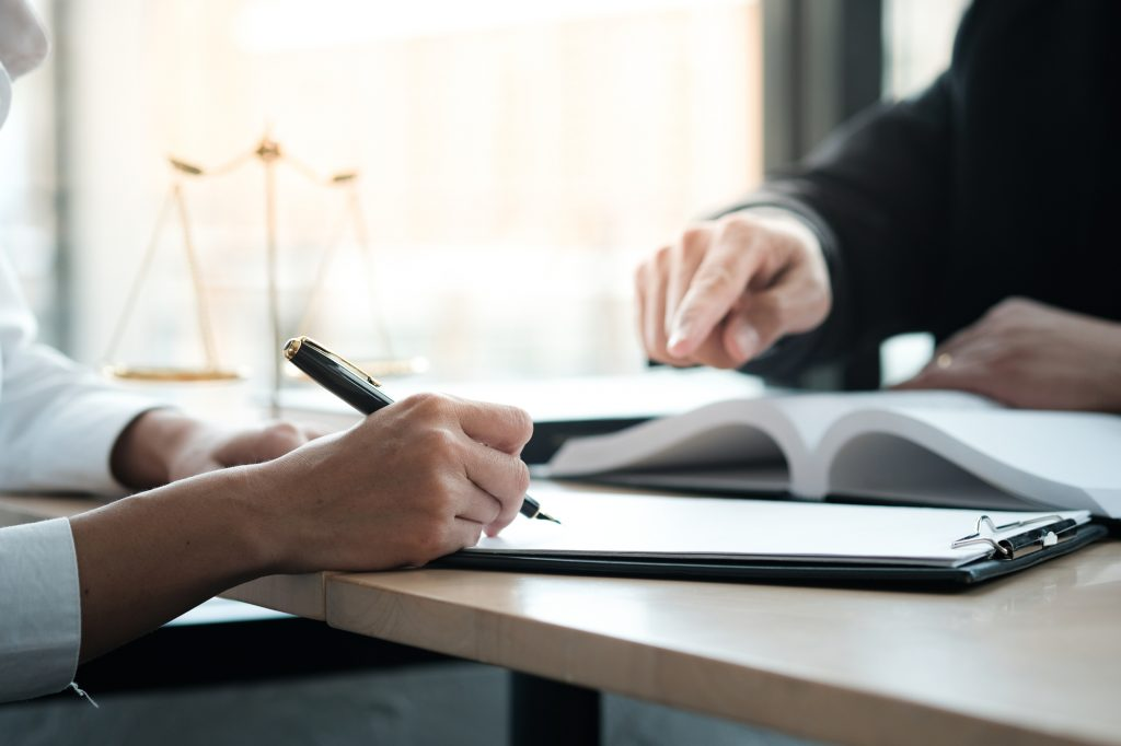 client and lawyer reviewing documents at a desk